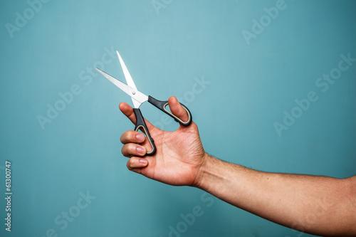 Fotografija Holding scissors