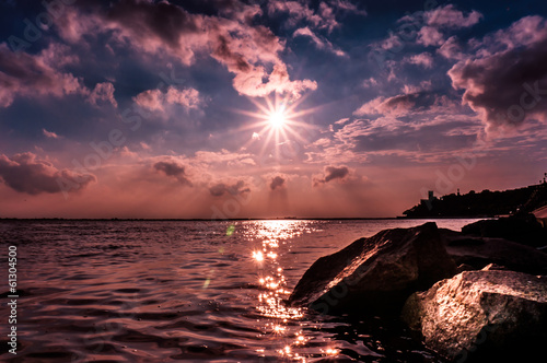Breathtaking sunset over rocky shore
