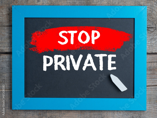 Photo  Stop Private on blackboard on wooden table