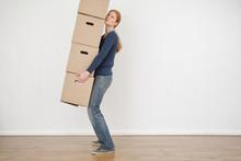 Woman Carrying Carton Storage Boxes