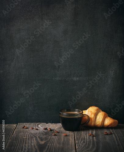 Fotografie, Obraz  coffee and croissant on blackboard background. copy space