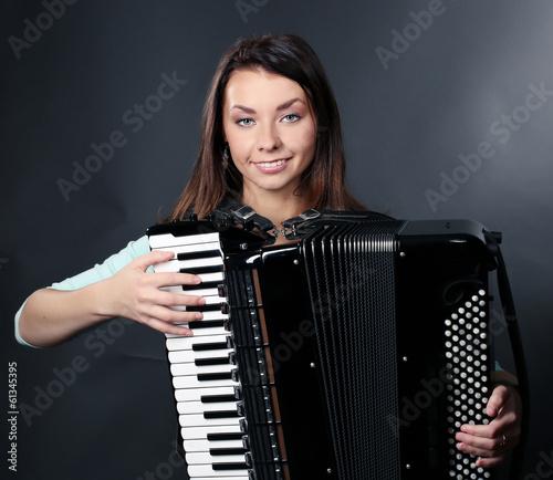Fotografija  portrait of beautiful fashionable woman on dark background