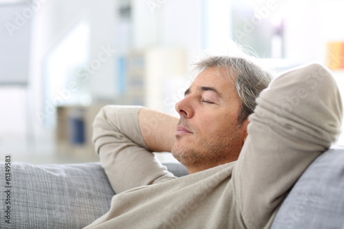 Deurstickers Ontspanning Man taking a nap in sofa at thome
