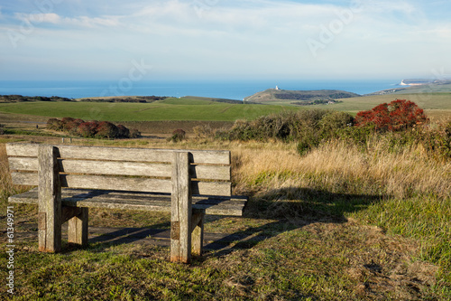 Spoed Foto op Canvas Grijze traf. Empty wooden bench facing english countryside