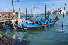 Gondolas At Pier. Venice. Italy.
