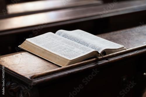 Fotografie, Obraz  Open Bible on a church bench