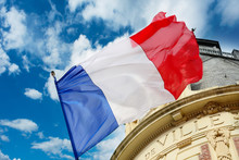 French Flag Waiving Over Some ...