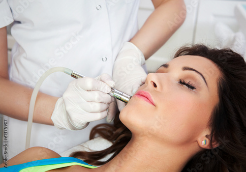 Valokuvatapetti Woman getting laser face treatment in medical spa center