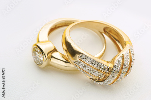 obraz PCV Biżuteria Złote pierścionki z diamentem