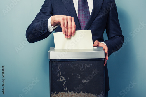 Obraz na plátně  Businessman shredding documents