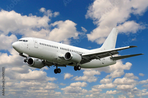 Fotografia  white plane landing