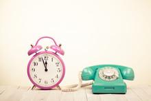 Retro Telephone And Alarm Clock On Table
