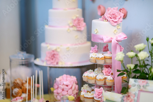 White wedding cupkace cake decorated with flowers