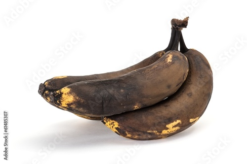 Old overripe bananas on a white background Canvas-taulu