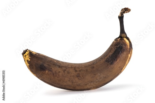 Valokuva  Side view of old overripe banana on white background