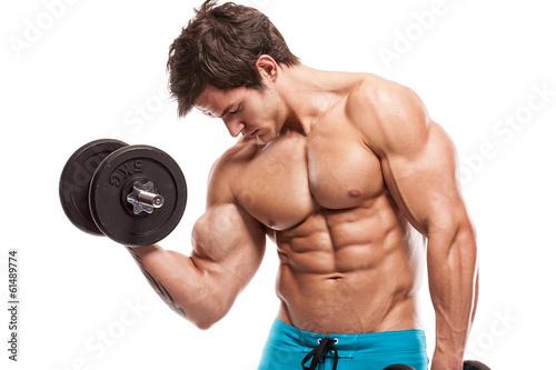 Muscular bodybuilder guy doing exercises with dumbbells over whi Plakat
