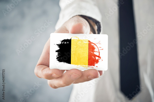 Belgian businessman holding business card with belgium flag buy belgian businessman holding business card with belgium flag reheart Choice Image