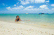 Girl lying in the water at the beach of the Koh Ngai island Thai