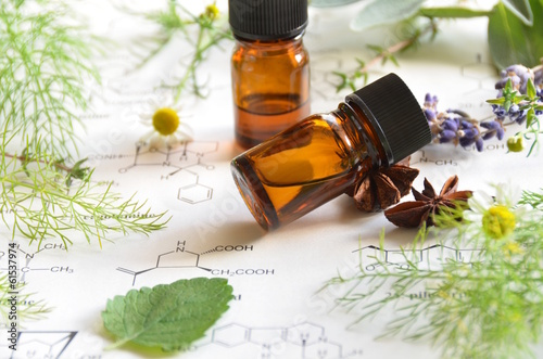 Vászonkép  aromatherapy on science sheet with herbs