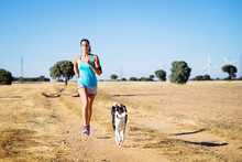 Woman Running Cross Trail In C...
