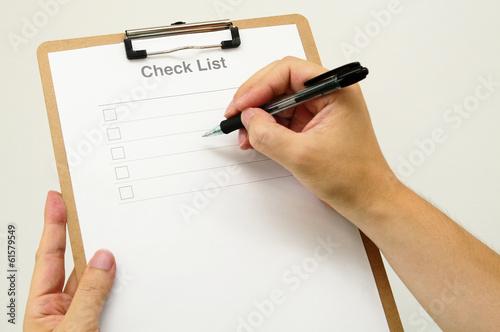 Fotografie, Obraz  チェックリストと男性の手