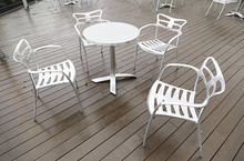 Metal Chairs And Table On A Te...