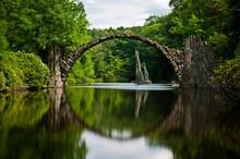 Very Old Stone Bridge Over The Quiet Lake