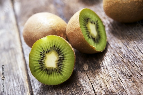 Fotografie, Tablou  Organic Kiwis on Wood
