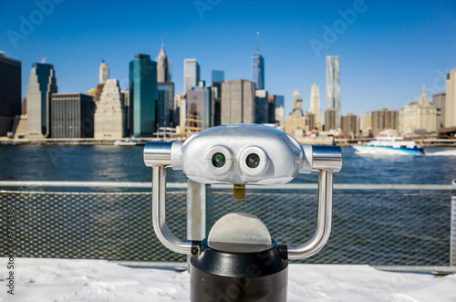 A binocular in Brooklyn Bridge Park view of New York city Poster
