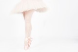 A ballet dancer standing on toes while dancing artistic conversi