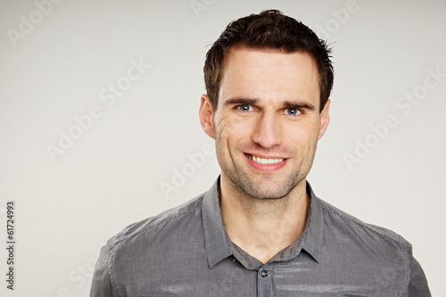 Fotografia  Portrait of a handsome man at shirt