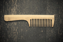Wooden Comb On A Gray Backgrou...