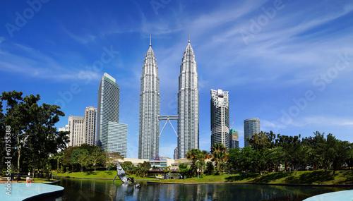 Photo Stands Kuala Lumpur Petronas Twin Towers at Kuala Lumpur, Malaysia.
