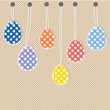 Easter eggs hanging from strings