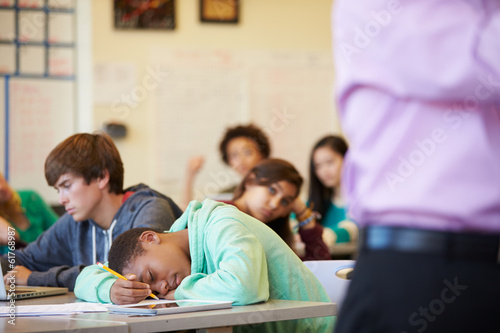 Fotografie, Obraz  Bored High School Pupil Slumped On Desk In Classroom