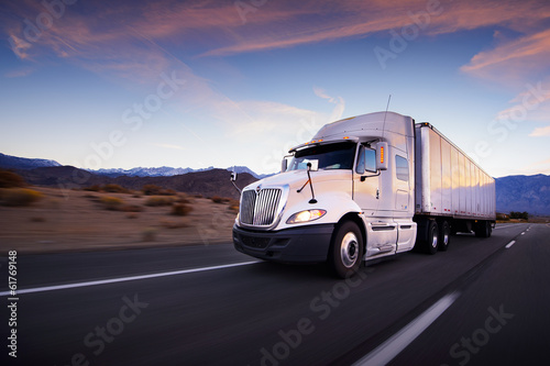 Photo  Truck and highway at sunset - transportation background