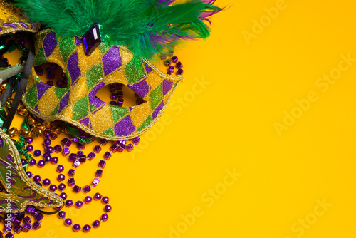 Fototapeta Colorful group of Mardi Gras or venetian mask on yellow