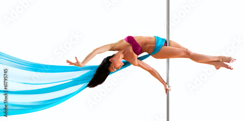 Fotografie, Obraz  Young pole dance woman. Bright white colors.