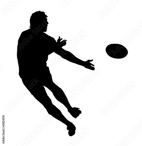 Fotografie, Obraz  Side Profile of Rugby Speedster Passing the Ball