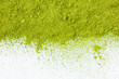 canvas print picture - border of powdered green tea top view close up isolated on white