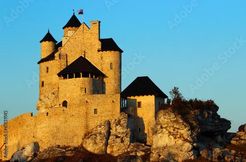Zamek w Bobolicach w promieniach zachodzącego słońca Poster
