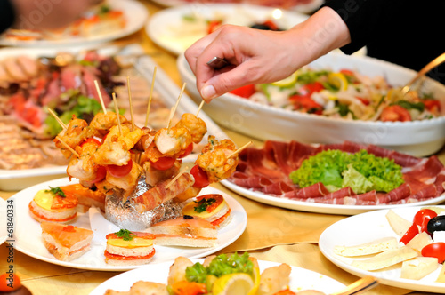 Human taking food on the party