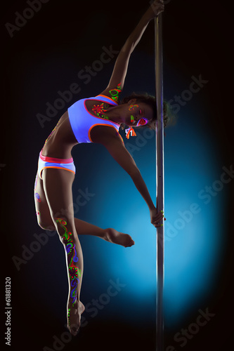 Foto op Plexiglas womenART Sexy dancer with disco makeup posing on pylon
