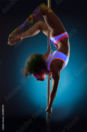 Foto op Plexiglas womenART Image of slim girl dancing on pole under UV light