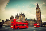 Fototapeta London - London, the UK. Red bus in motion and Big Ben