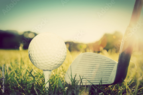 Spoed Foto op Canvas Golf Playing golf, ball on tee and golf club. Vintage, retro style