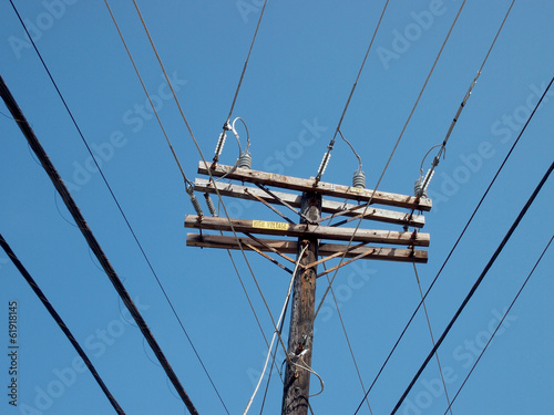 Fotografie, Obraz  High Voltage Power Lines intersect at a wooden power pole