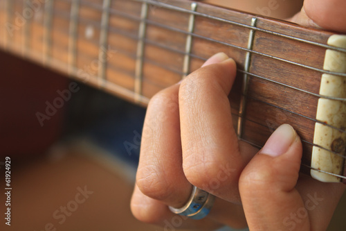 Fotografiet  girl hand playing acoustic guitar