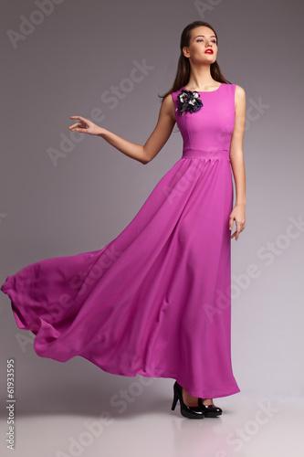 Foto  Girl in magenta dress. Portrait. Studio. Fashion
