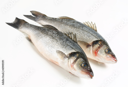 Fotobehang Vis Two fresh sea bass fish